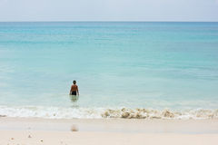 A young boy stands at the ocean shore Royalty Free Stock Photography