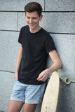Young boy stands relying on the longboard Royalty Free Stock Images