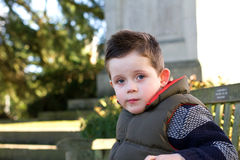 Young boy staring ahead with emotion on face Royalty Free Stock Image