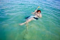 Young boy starts snorkeling Stock Photo