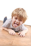 Young boy sticking tongue out Royalty Free Stock Images
