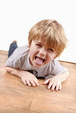 Young boy sticking tongue out stock images