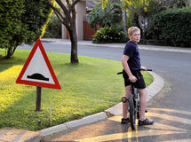 Young Boy Stopped Bicycle at Speed Bump Stock Image