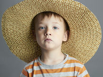 Young boy with straw hat.funny child Royalty Free Stock Photo