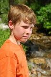 Young boy by a stream Stock Photos