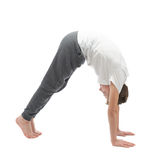 Young boy stretching or doing yoga Royalty Free Stock Images