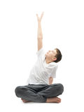 Young boy stretching or doing yoga Stock Photo