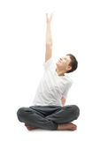 Young boy stretching or doing yoga Royalty Free Stock Photography