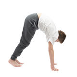 Young boy stretching or doing yoga Royalty Free Stock Photos