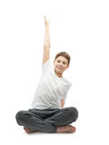 Young boy stretching or doing yoga Royalty Free Stock Photo