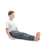 Young boy stretching or doing yoga Royalty Free Stock Image
