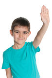 Young boy stretching his right hand up Royalty Free Stock Photos