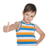 Young boy in the striped shirt holds his thumb up Stock Photo