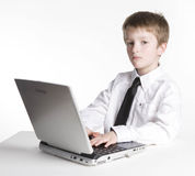 Young Boy Student on Laptop Computer Stock Photo