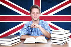 Young Boy Student On The Background With UK Flag Stock Photo