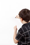 Young boy student in a writing on a whiteboard Stock Photography