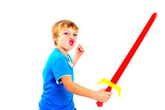 Young boy in studio playing with sword on white background royalty free stock photos