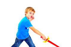 Young boy in studio playing with sword on white background Stock Photos