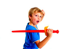 Young boy in studio playing with sword on white background royalty free stock photography
