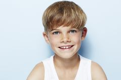 Young boy in studio, smiling Stock Photos