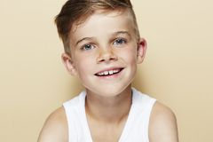 Young boy in studio, smiling Stock Images