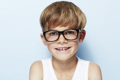 Young boy in studio, smiling Royalty Free Stock Photo