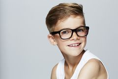 Young boy in studio, smiling Stock Photo