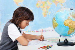 Young boy study geography Stock Photography