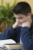 Boy studying book Royalty Free Stock Photos