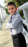 Young boy in suit with arms crossed Royalty Free Stock Images