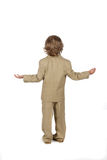 Young boy in suit with arms out Stock Image