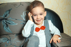 Young boy in suit and bowtie Stock Photo