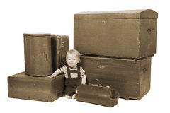 Young boy with suitcases and boxes Stock Image