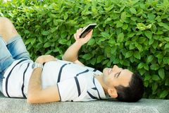 Young boy with smartphone royalty free stock photography