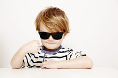 Young boy in sunglasses Royalty Free Stock Images