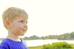 Young boy smiling white space Royalty Free Stock Images