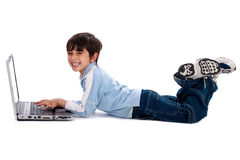 Young boy surfing on his laptop Royalty Free Stock Image