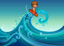 A young boy surfing Royalty Free Stock Images