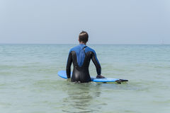 Young boy surfing in the sea Royalty Free Stock Photography