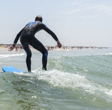 Young boy surfing in the sea Stock Photos
