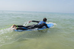 Young boy surfing in the sea Royalty Free Stock Images