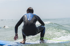 Young boy surfing in the sea Royalty Free Stock Photos