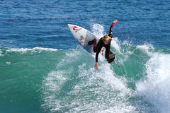 Young Boy Surfing a Wave in California stock photo