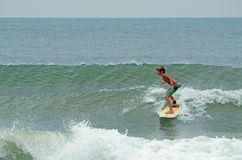 Young Boy Surfing Wrightsville Beach, NC. Young Caucasian boy surfing short board in the waves at Wrightsville Beach, NC on a hot summer day Stock Images