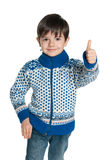 Young boy in a sweater holds his thumb up Royalty Free Stock Image