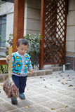 Young boy sweeping leaves Royalty Free Stock Image