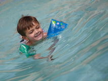 Young boy swiming Stock Photo