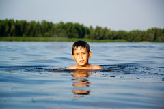 Young boy swiming in water Royalty Free Stock Photography
