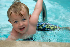 Young boy swimming stock photo