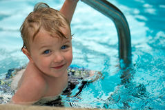 Young boy swimming. Young boy in swimming pool,  smiling Stock Photography